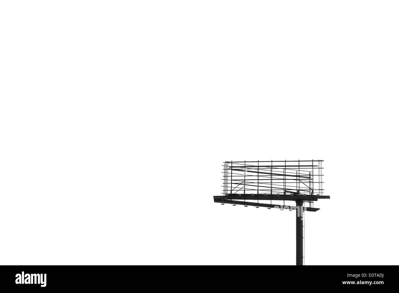 Detail of billboard signage with white sky. - Stock Image