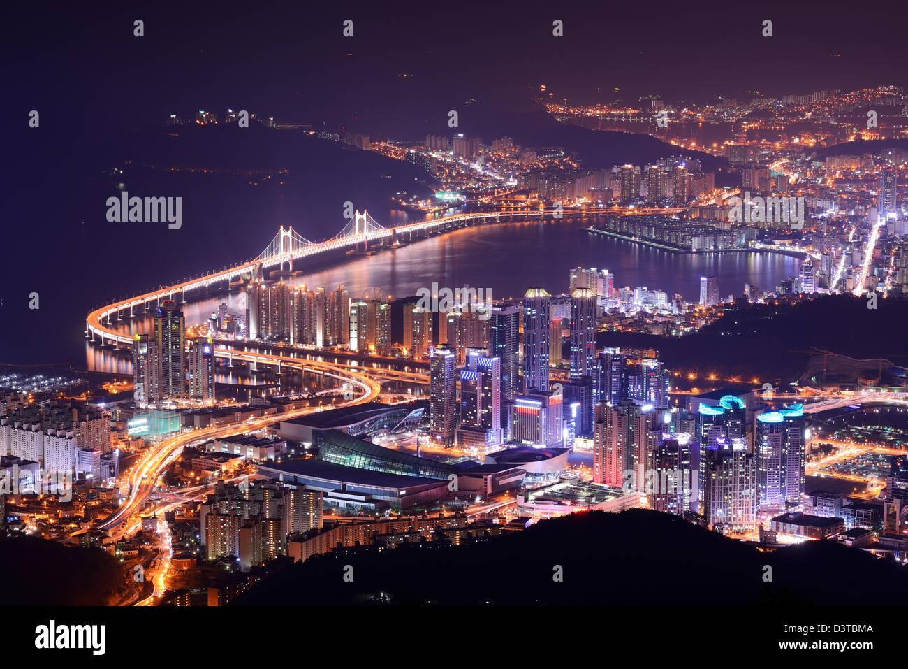 Skyline of Busan, South Korea at night. - Stock Image