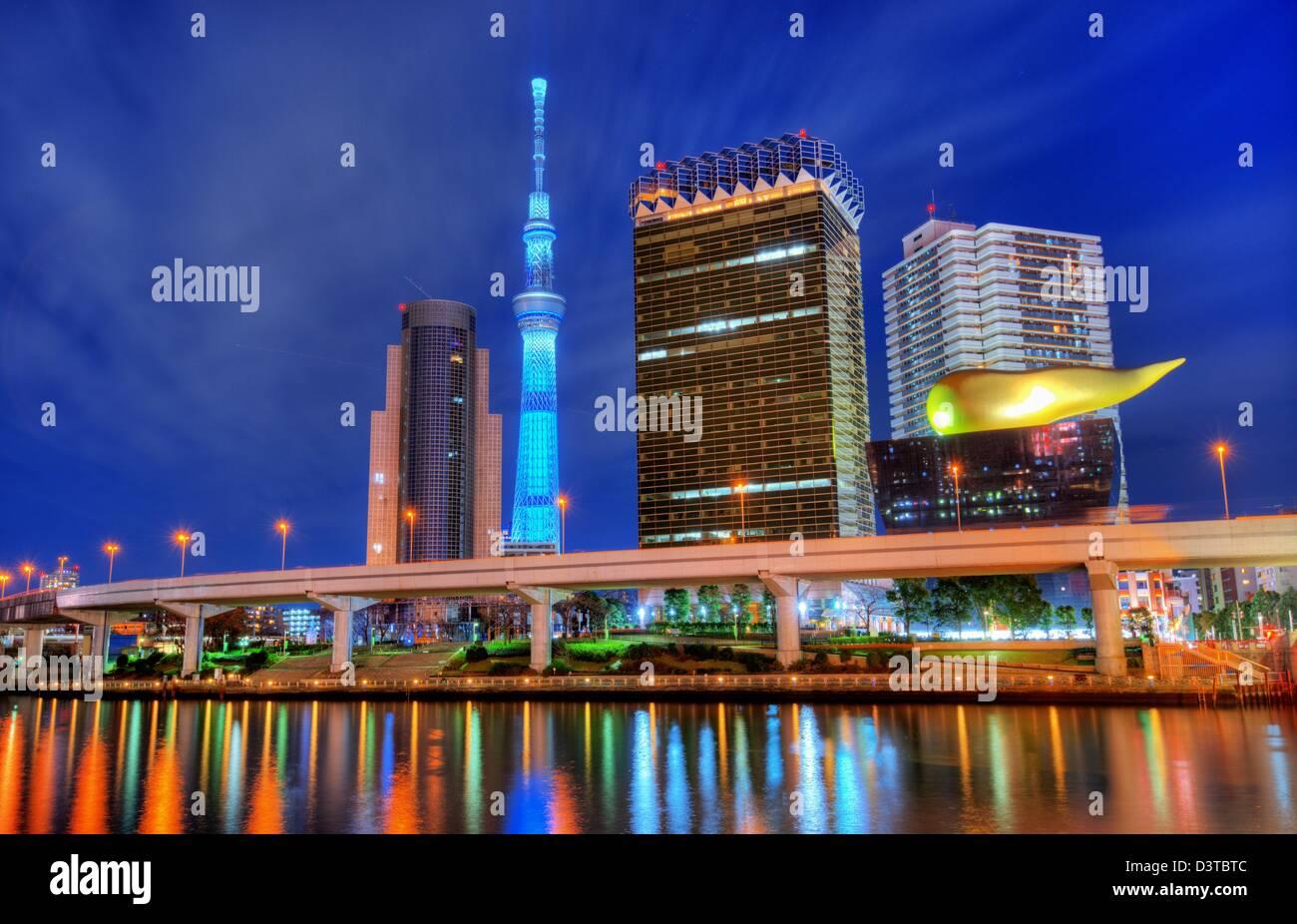 Landmark buildings line the Sumida River at Asakusa in Tokyo, Japan. - Stock Image