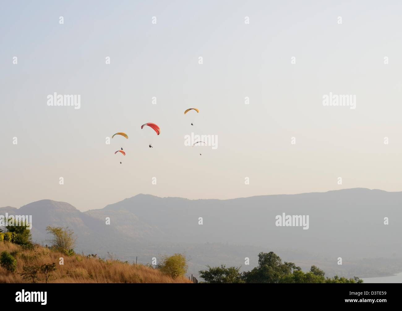 Paragliders over the hills - Stock Image