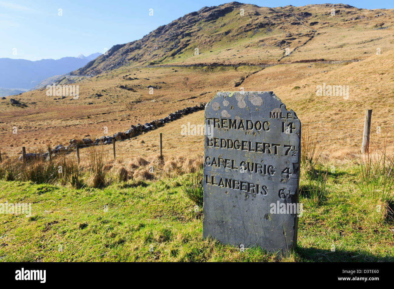 Old slate milestone showing distances in imperial miles above Nant Gwynant in Snowdonia National Park, Gwynedd, - Stock Image