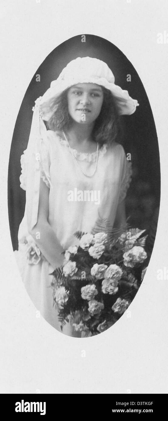A young Portuguese American girl in New Bedford, Massachusetts, is a flower girl in a relative's wedding in - Stock Image