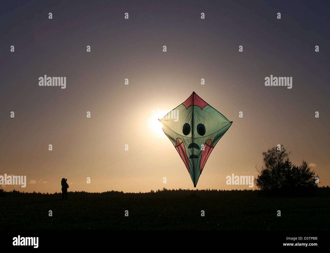 The picture shows a kite in the air at sunset near Irsee, Germany, Tuesday, 24 October 2006. Kites are originally - Stock Image