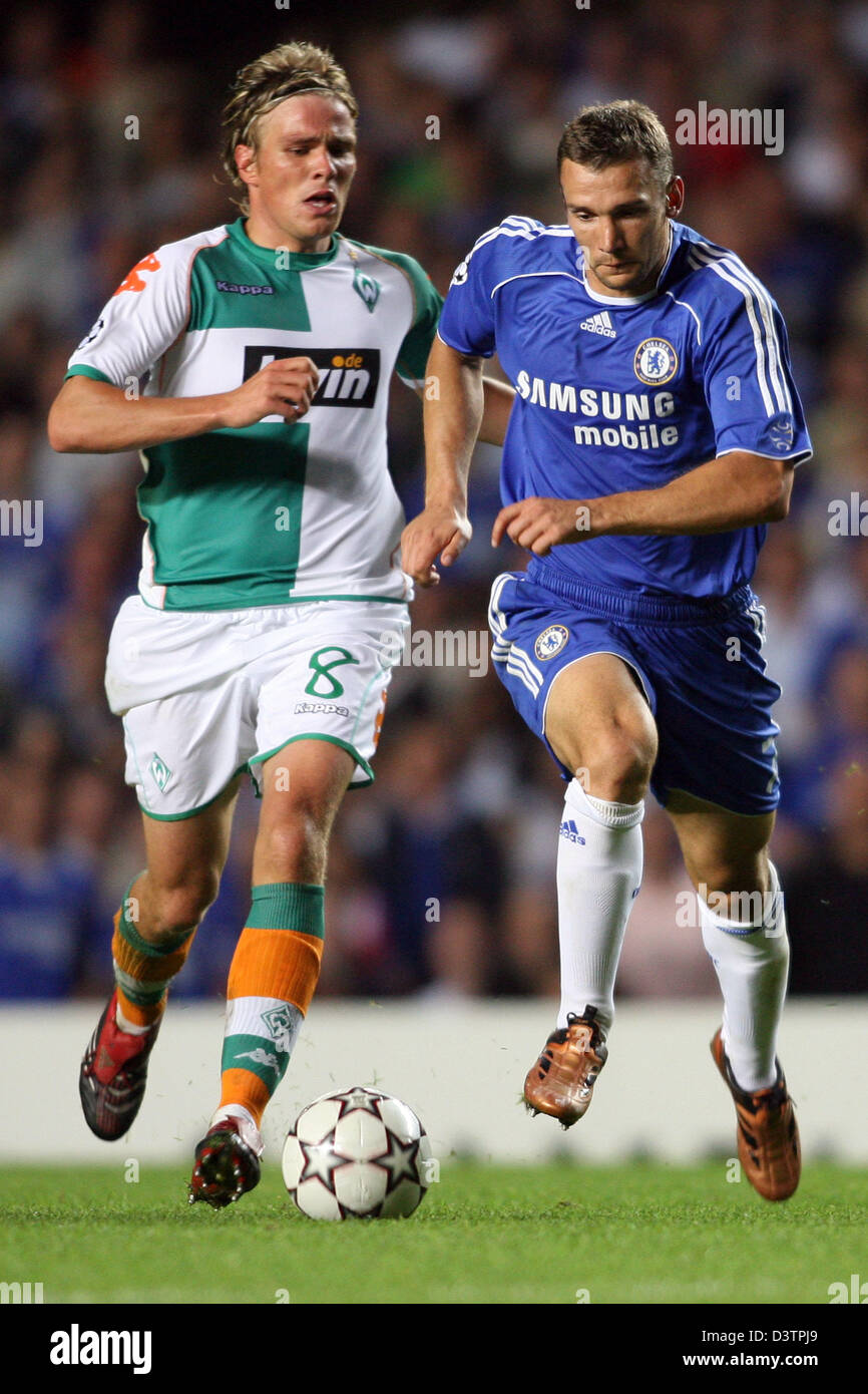Bremen's Clemens Fritz (L) and Chelsea's Andrey Shevchenko shown in action during the Champions League match between Stock Photo