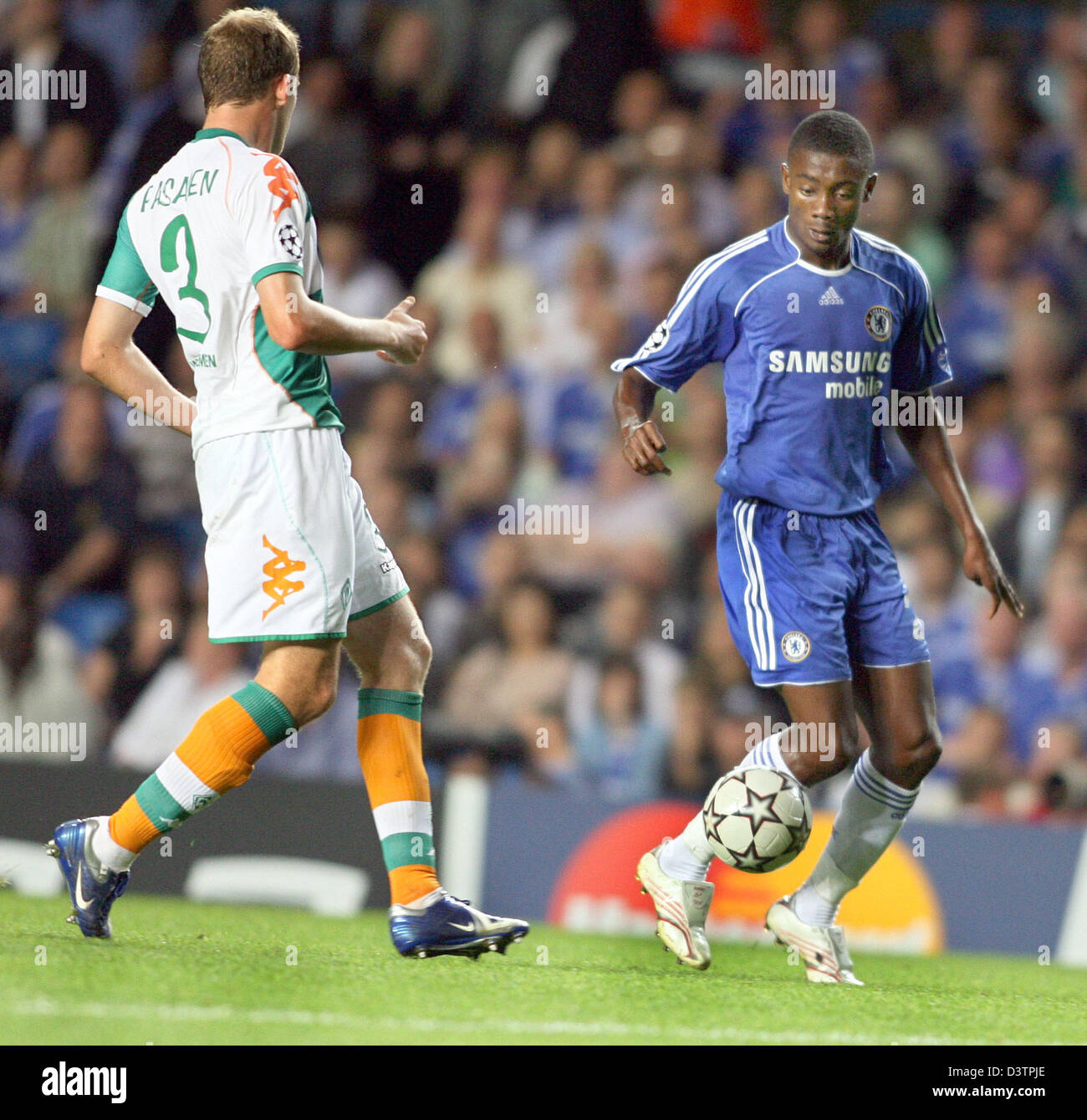Bremen's Petri Pasanen (L) and Chelsea's Salomon Kalou (R) shown in action during the Champions League match between Stock Photo