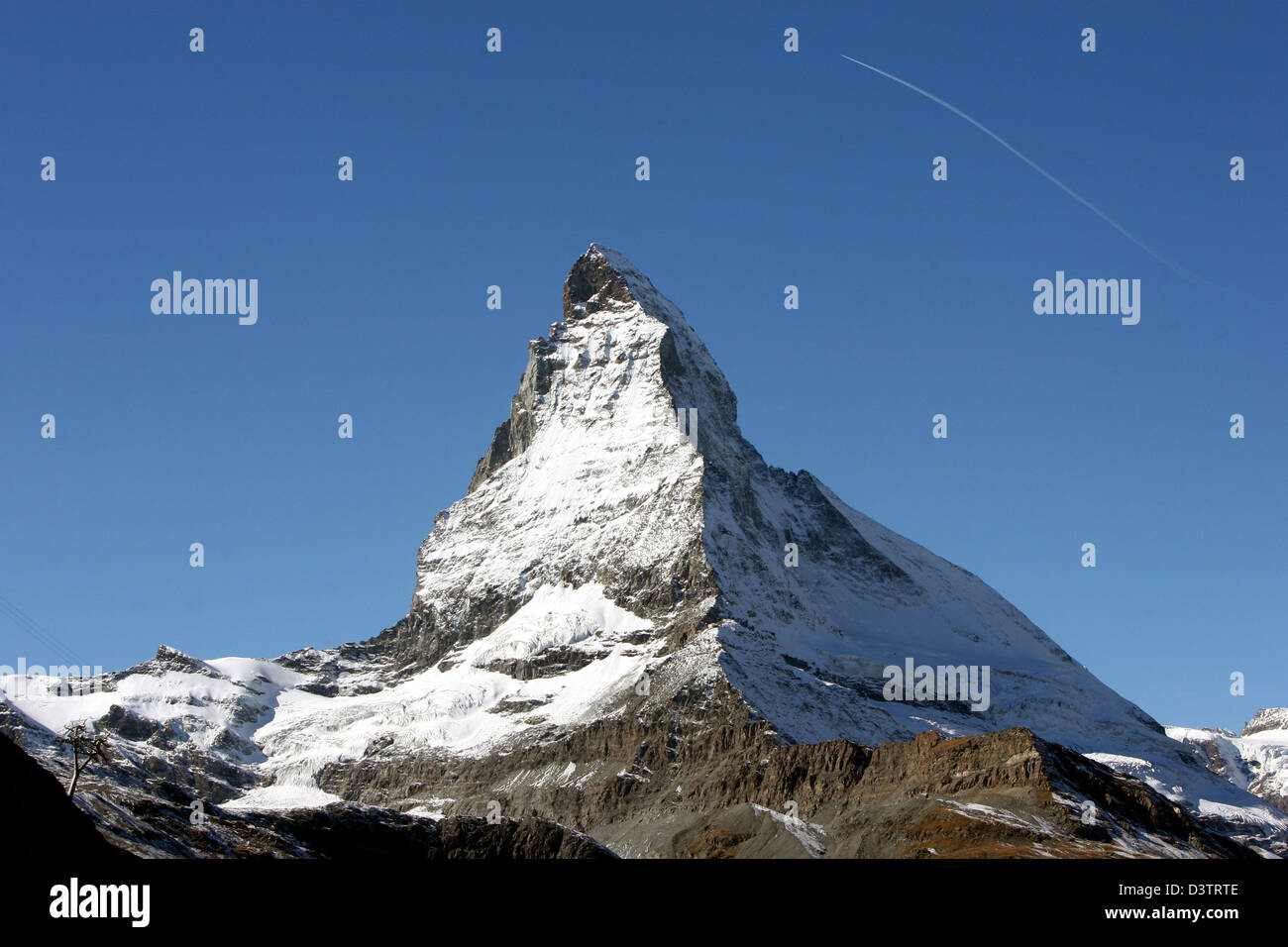 The photo shows the snow covered summit of the Matterhorn mountain above Zermatt in the Swisss canton Wallis, Switzerland, Stock Photo