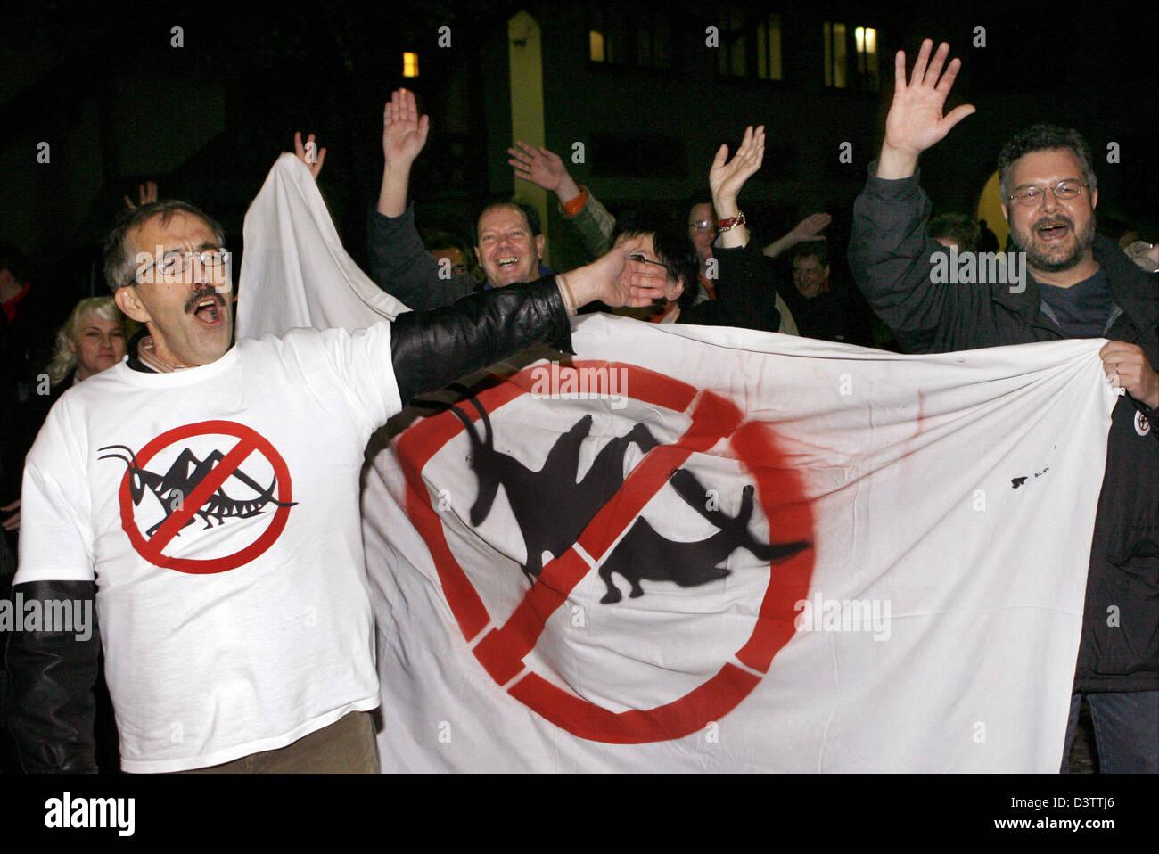 Members of a citizen initiative against the sale of municipal flats carrying anti-locusts banners celebrate in Freiburg, - Stock Image