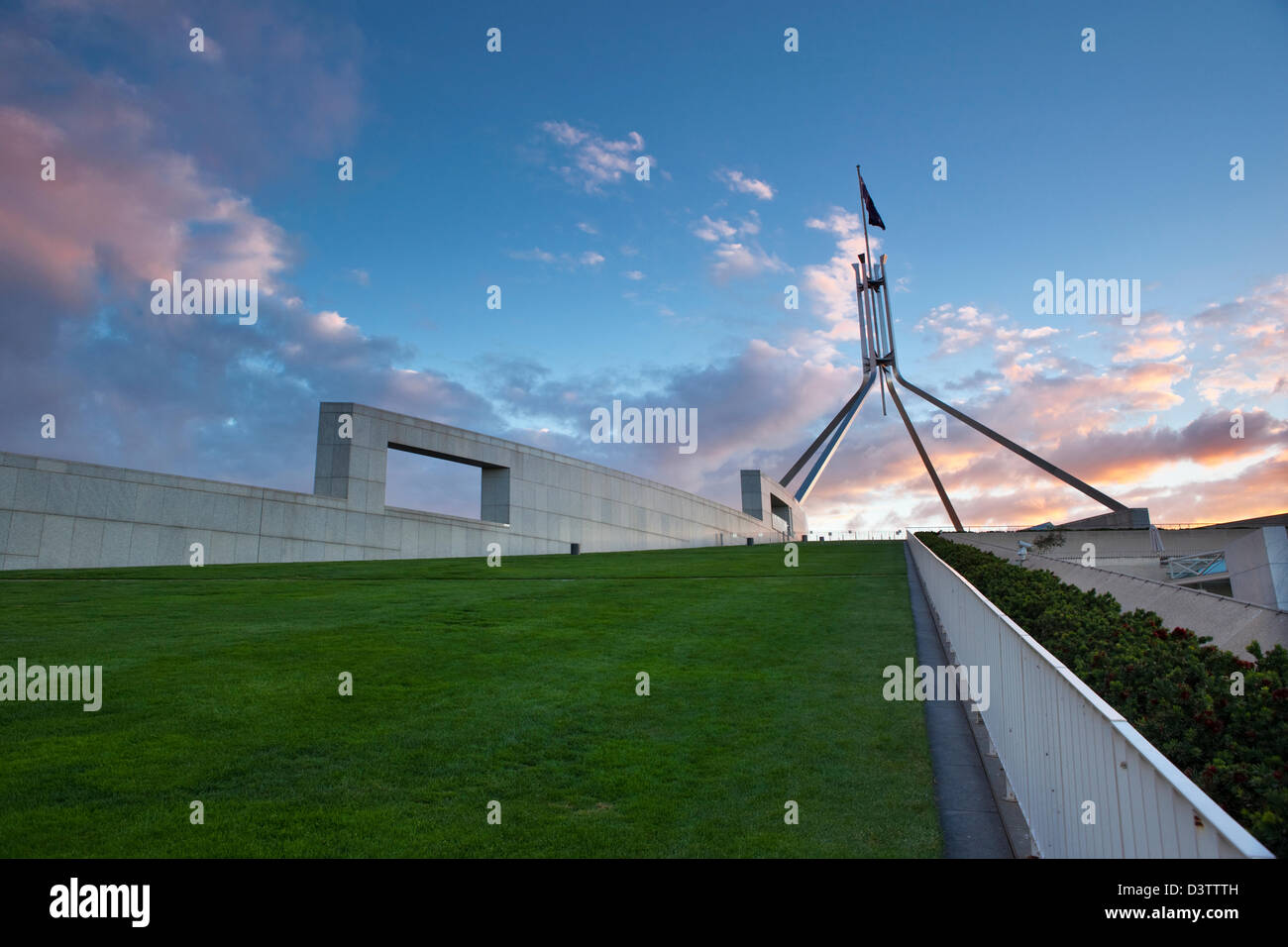 The rooftop lawn and flagpole of Parliament House at dusk. Canberra, Australian Capital Territory (ACT), Australia Stock Photo