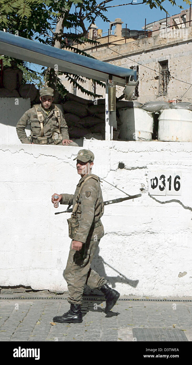 Greek border guards keep watch between the Greek and the