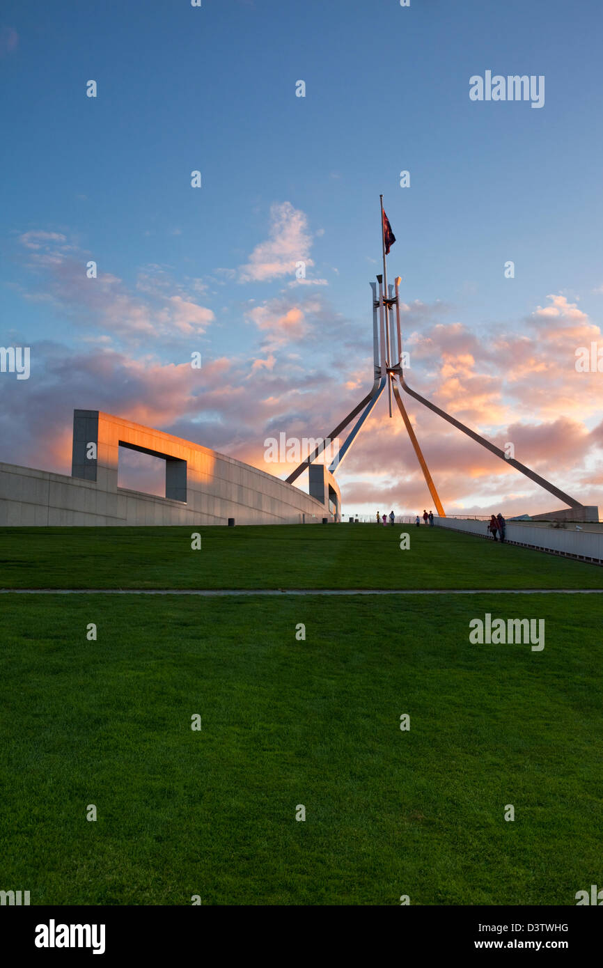 The rooftop lawn and flagpole of Parliament House at dusk. Canberra, Australian Capital Territory (ACT), Australia - Stock Image