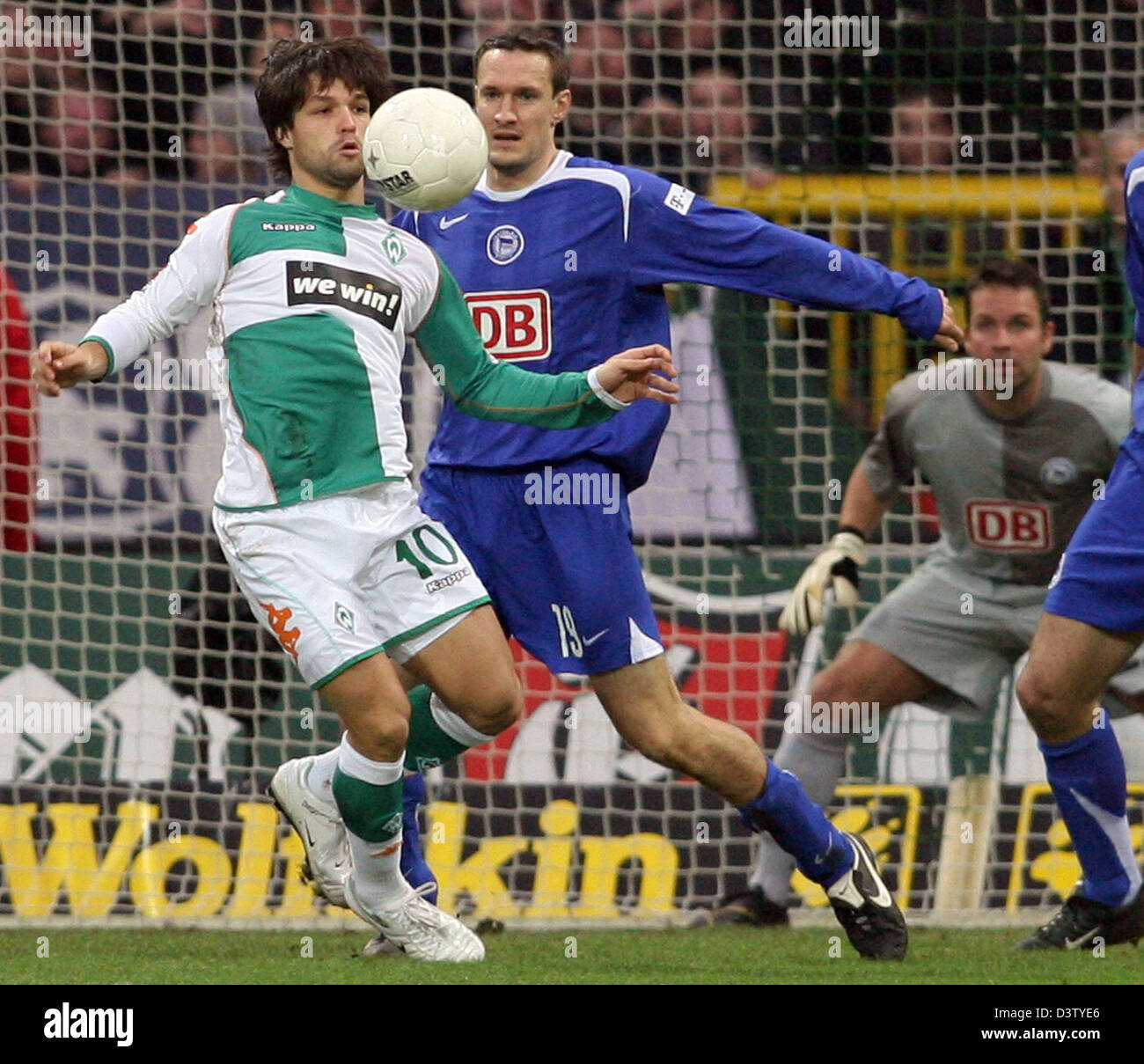 Diego (L) of Bremen beautifully gets in possession of the ball  before Berlin's Andreas Schmidt (R) during the - Stock Image