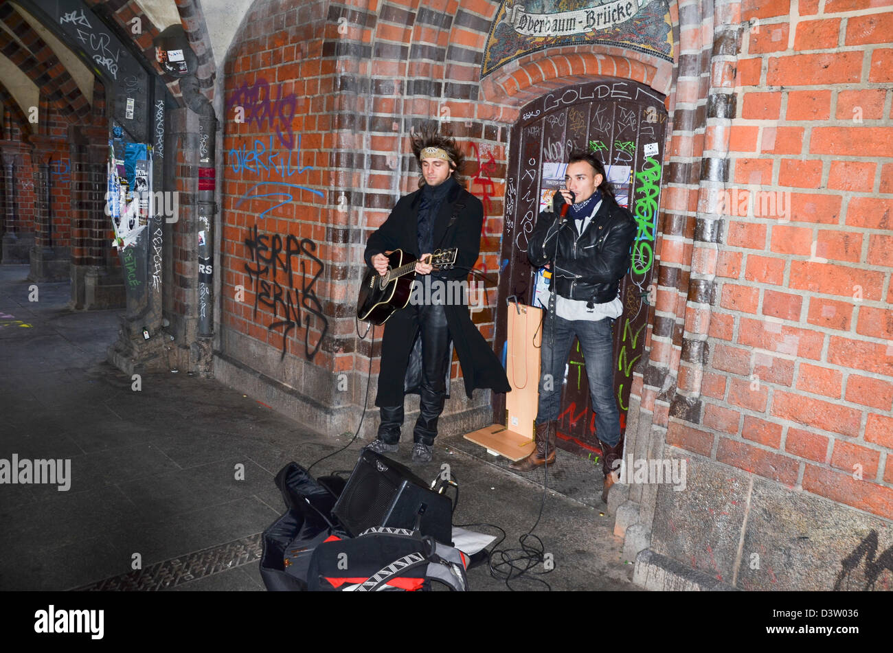 Germany, Berlin, two buskers playing on the Oberbaum Bridge - Stock Image