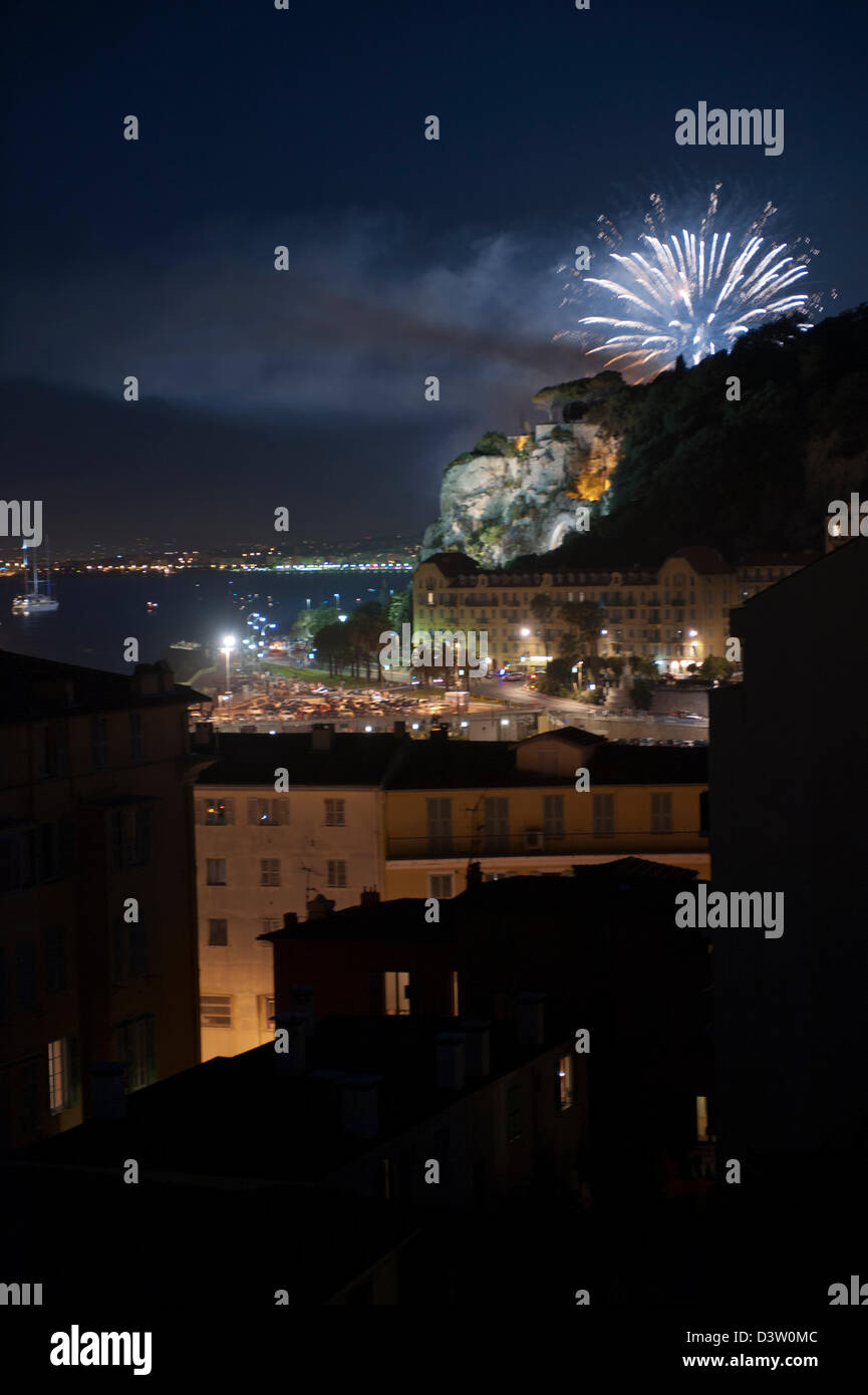 Fireworks over the port of Nice to celebrate Bastille Day. - Stock Image