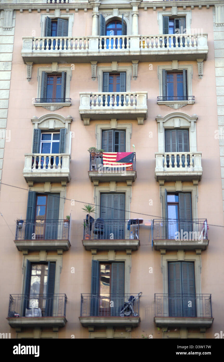CNT flag in a balcony of a Barcelona building. CNT is a labor union with anarchist past. - Stock Image
