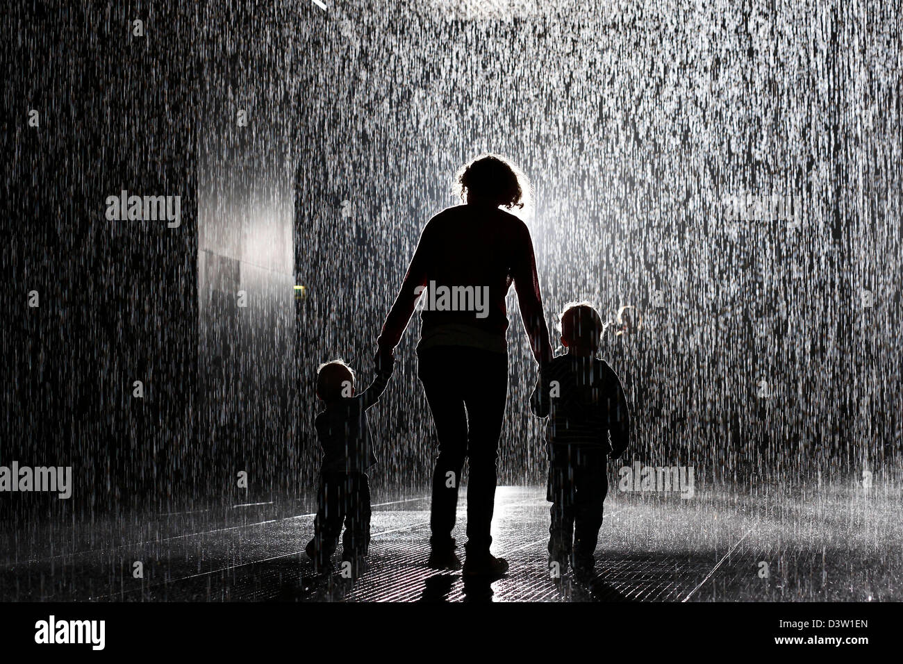 People interact with the \'Rain Room\' art installation by \'Random ...