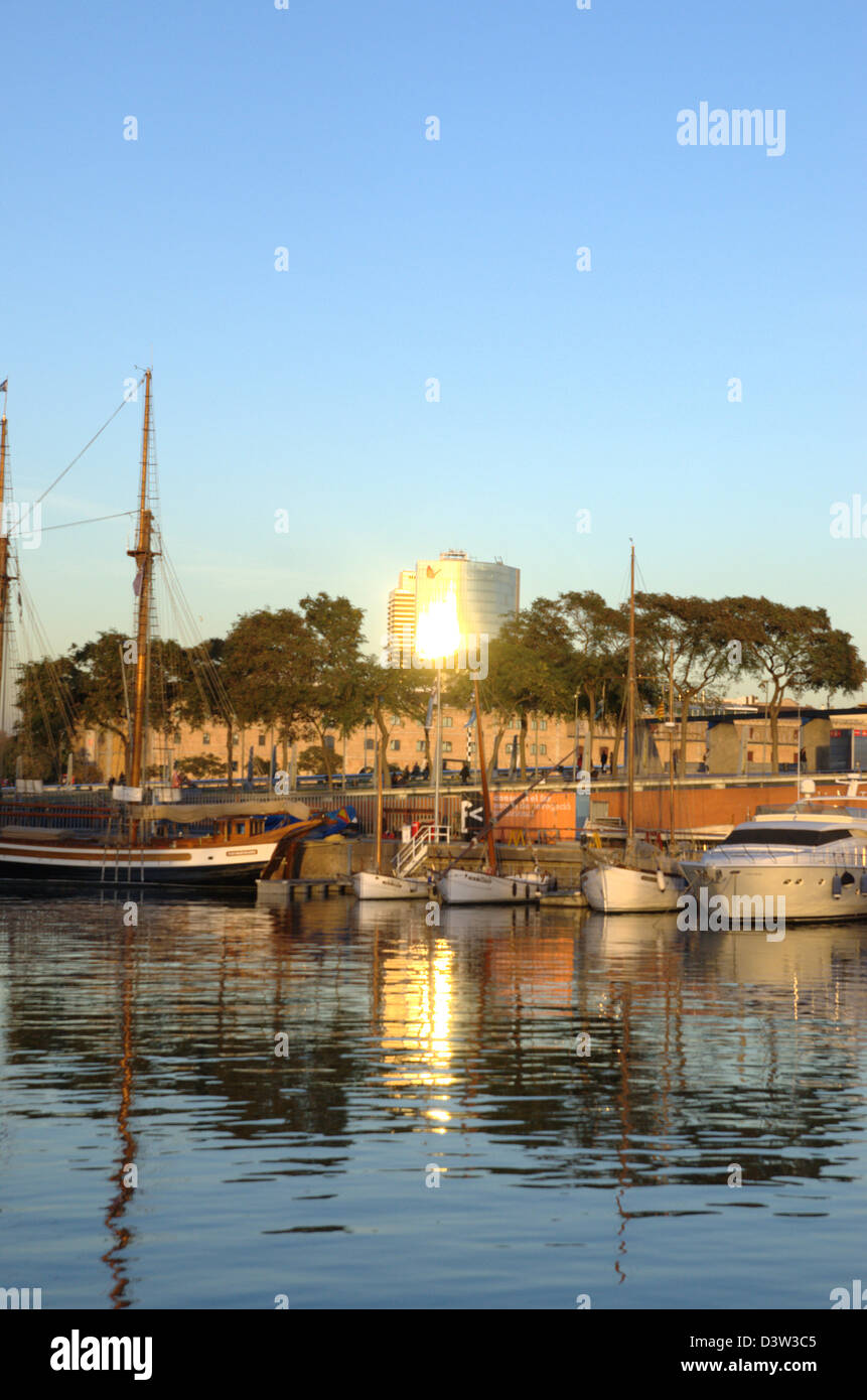 Gas Natural tower shines from Port Vell of Barcelona. - Stock Image