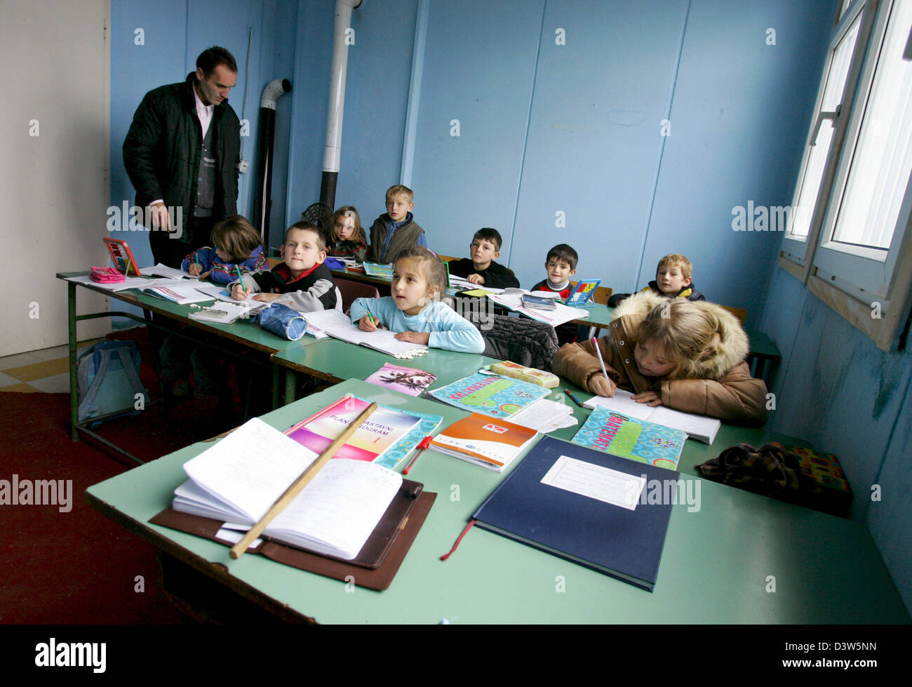 The picture shows  a teacher and his pupils in a school classroom in Nebregoste, Republic of Serbia, Wednesday, - Stock Image