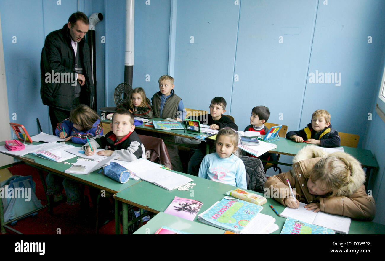 The picture shows a teacher (L) and his pupils in a school classroom in Nebregoste, Republic of Serbia, Wednesday, - Stock Image