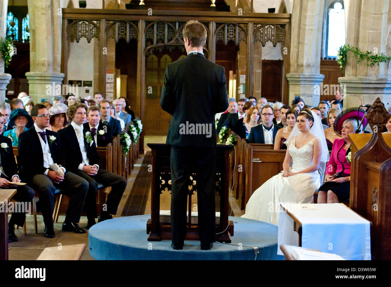 A Wedding Service Being Carried Out By A Vicar Inside A Church In