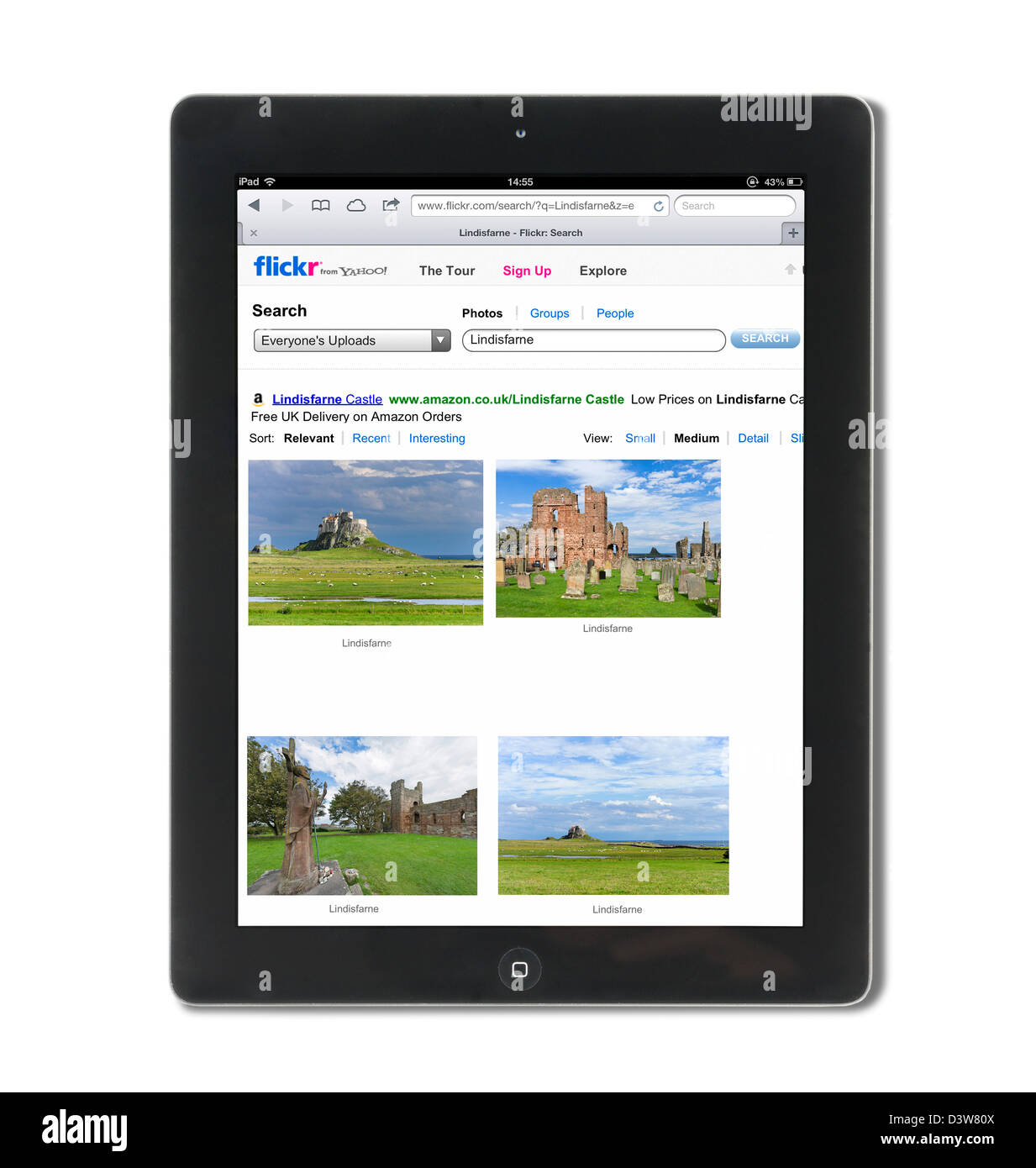 Photos on the Flickr photo sharing website viewed on a 4th generation iPad - Stock Image