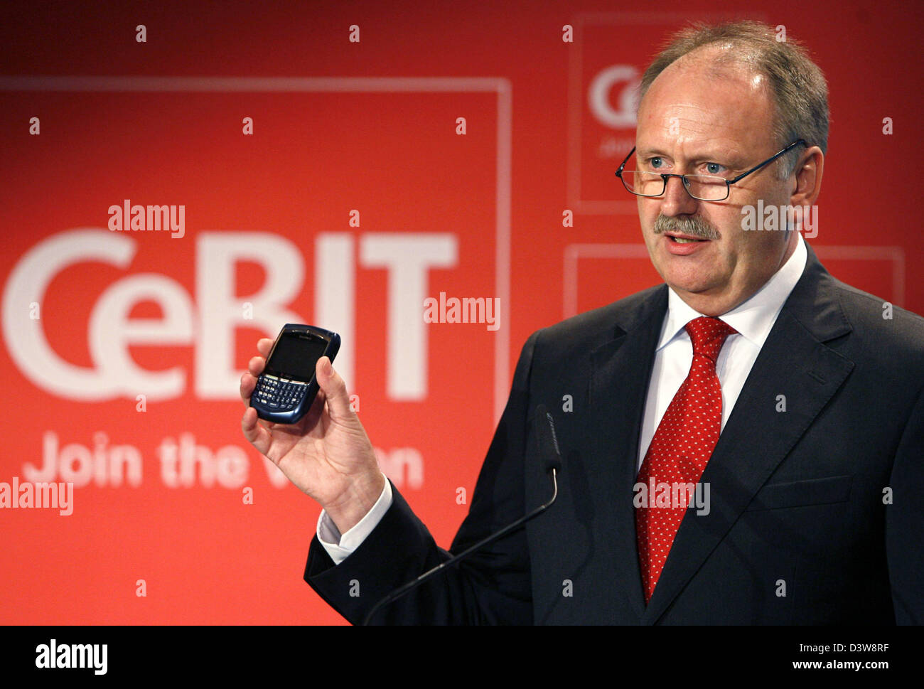 Ernst Raue, the CeBIT-director and member of the board of the 'Deutsche Messe AG Hanover', gestures at press conference in front of the CeBIT logo in Hanover, Germany, Tuesday, 23 January 2007. The computer trade fair CeBIT (15th to 21st March 2007) will record a major decrease in exhibition space due to the cancellations of big companies such as Nokia and Motorola. The trade fair' Stock Photo