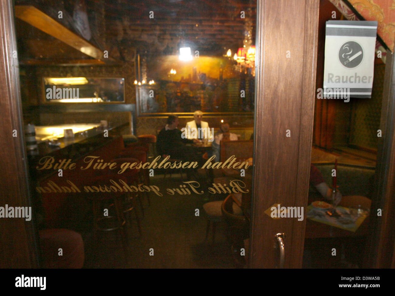 The smokers lounge of 'Cafe Weiss' seperates the smokers from the non-smokers as required by law in Stuttgart, - Stock Image