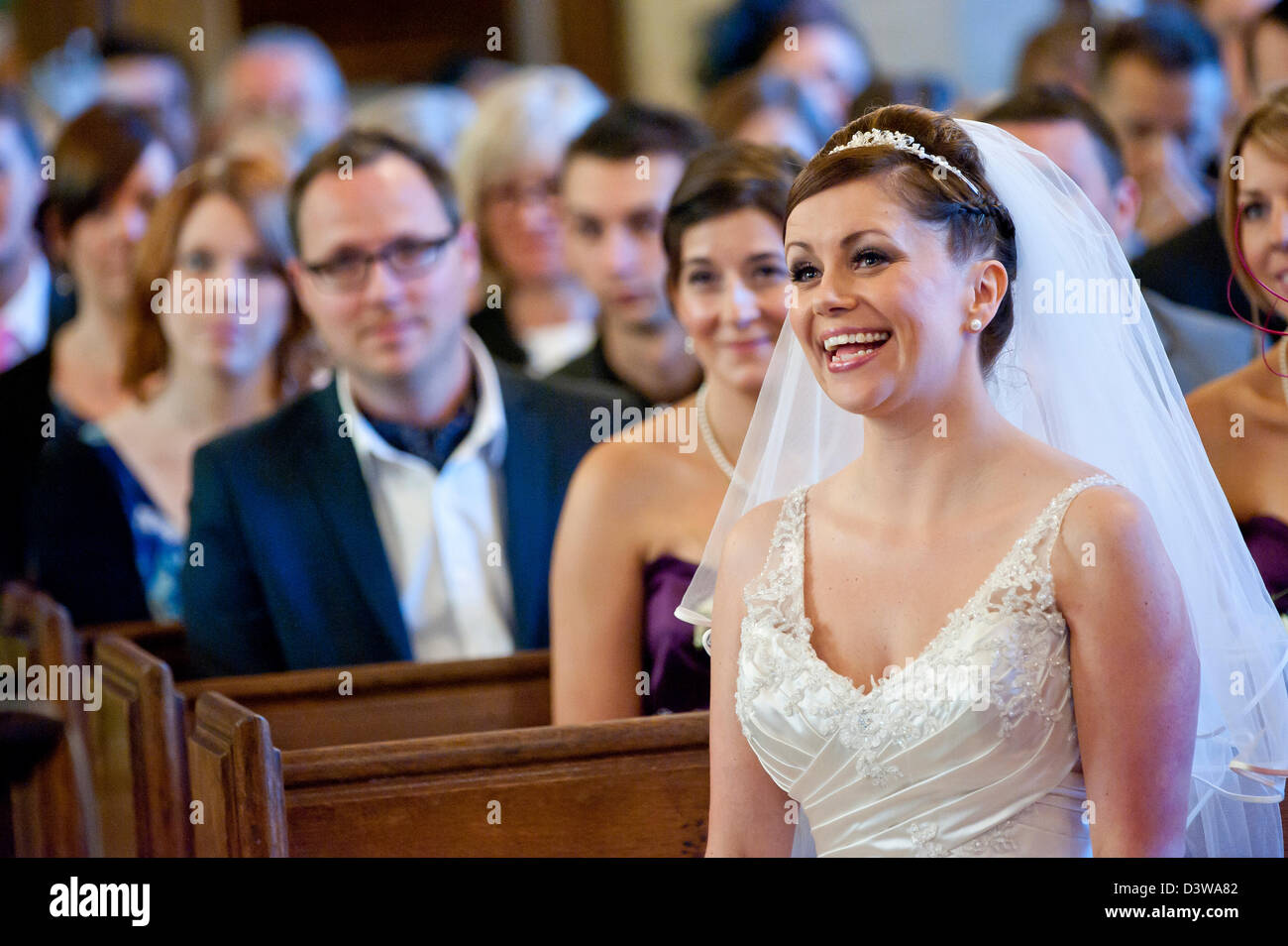 A Happy Bride At A Wedding Service Inside A Church In England Uk
