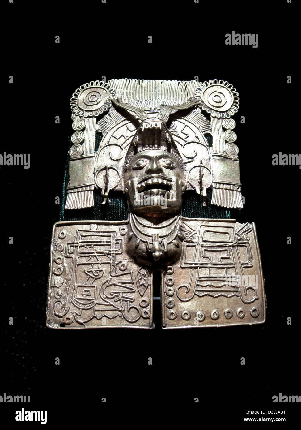 beautifully worked pre Columbian copper ornament displayed with Monte Alban tomb 7 treasure in Museum of Oaxacan - Stock Image