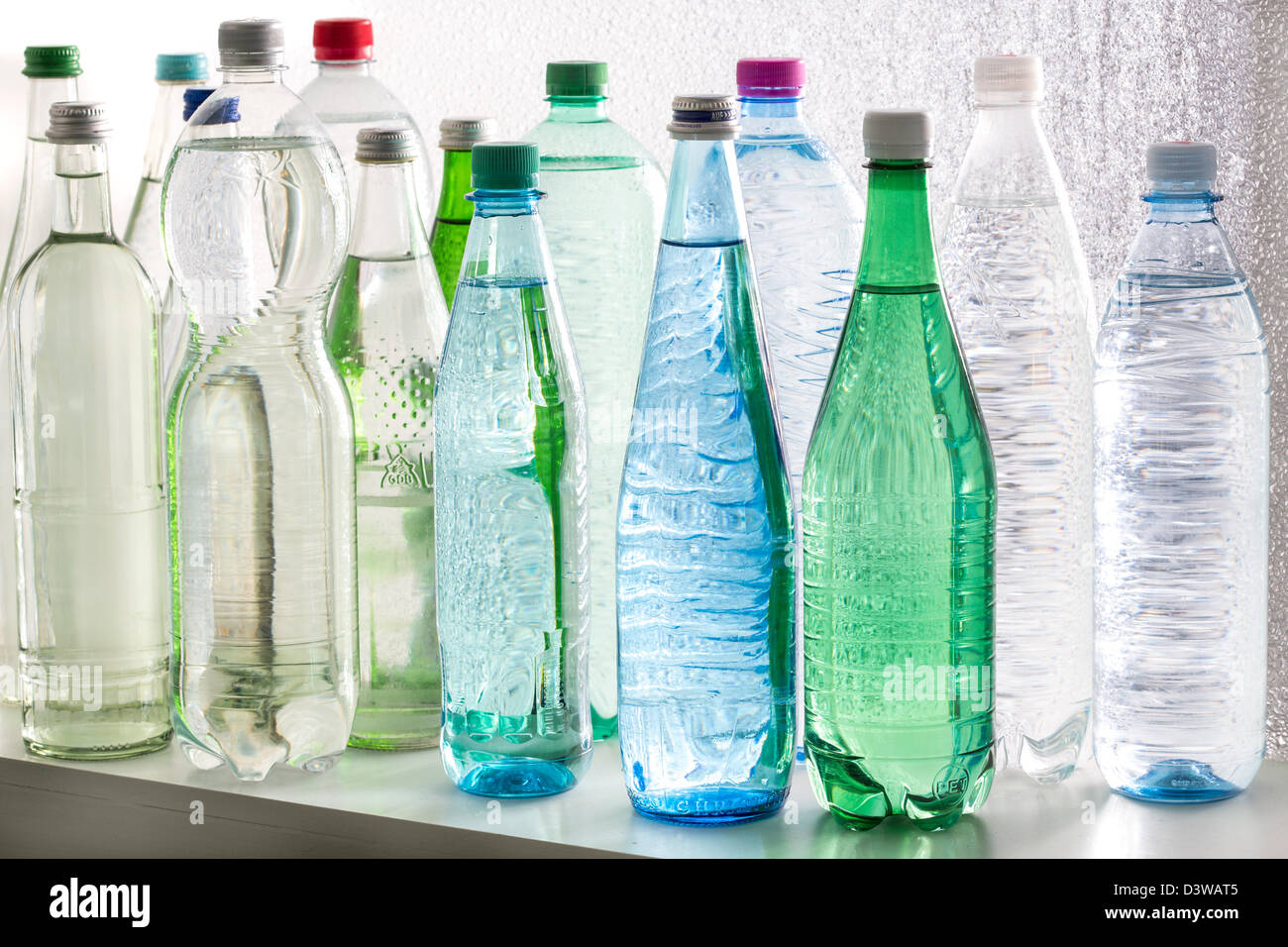 Different types of bottled mineral and table waters. - Stock Image