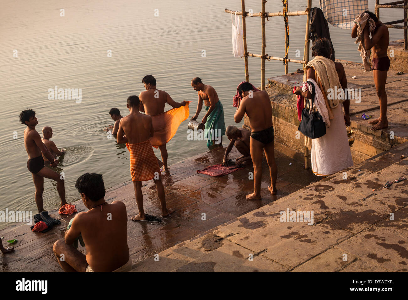 5673abd1717 Indian men bathing in the Ganges river, Varanasi, India Stock Photo ...