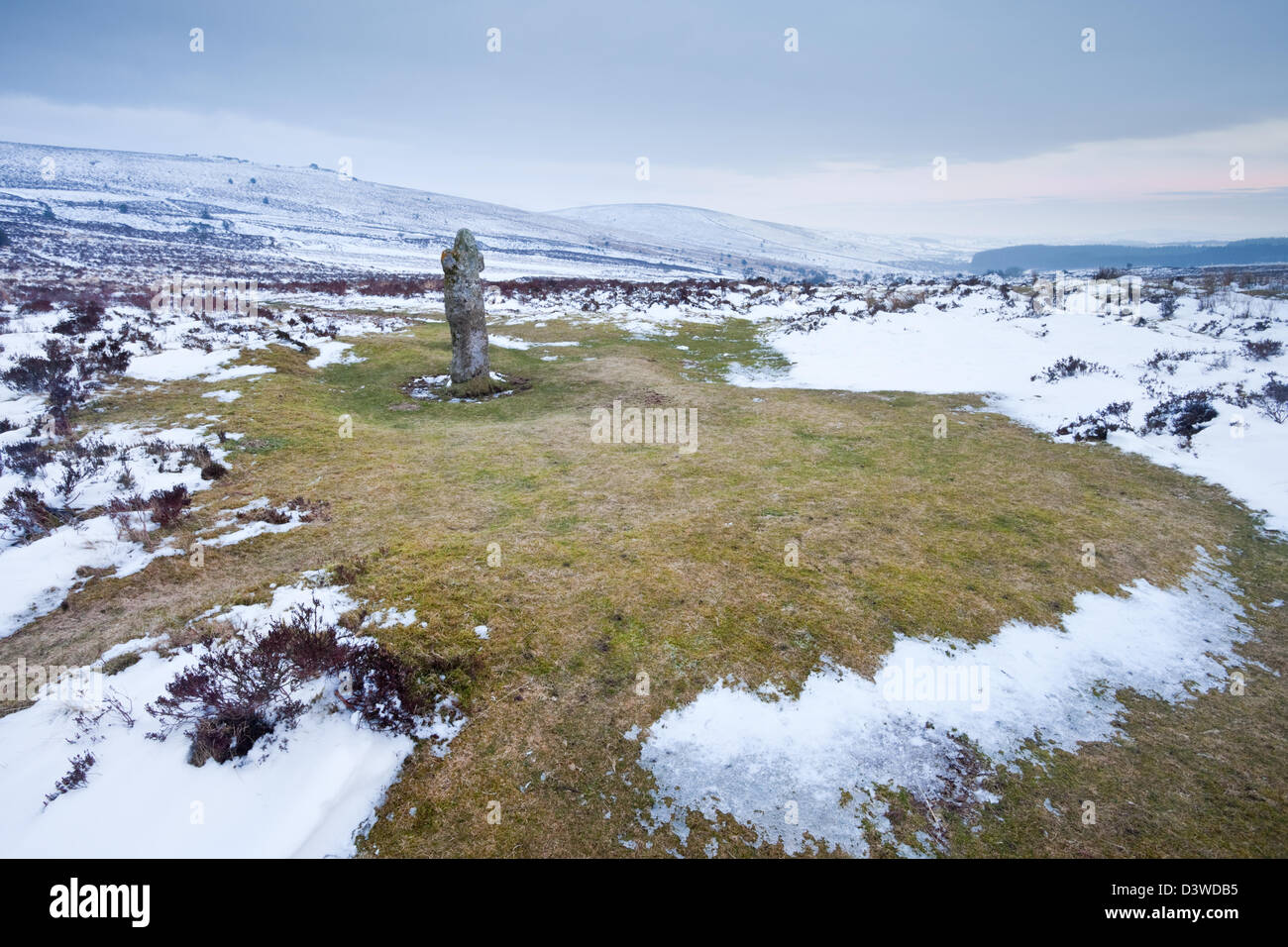 A snow covered moorland surrounding Bennett's cross - Stock Image