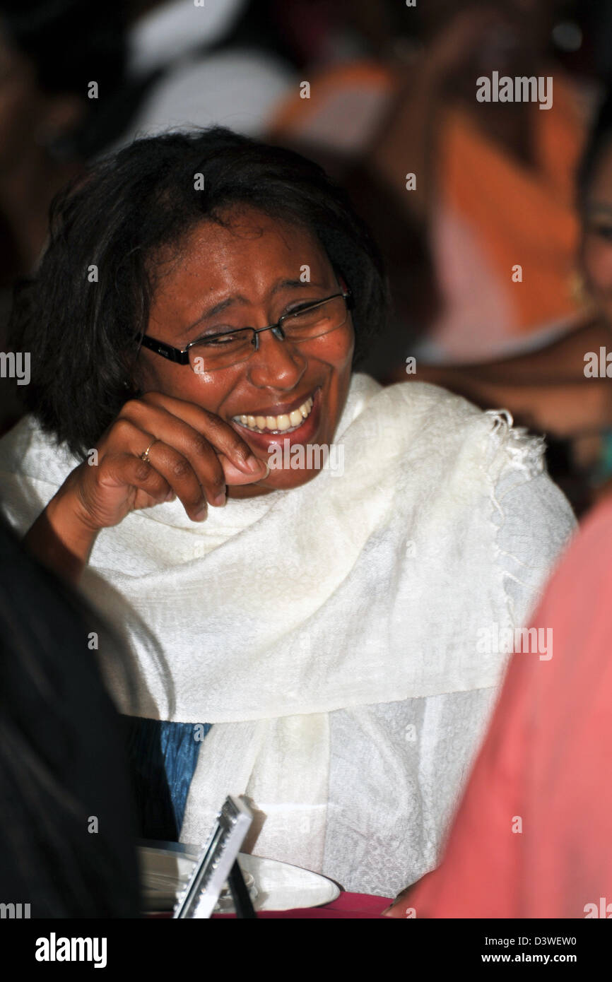 A woman laughing in hysterics at a South African wedding. - Stock Image