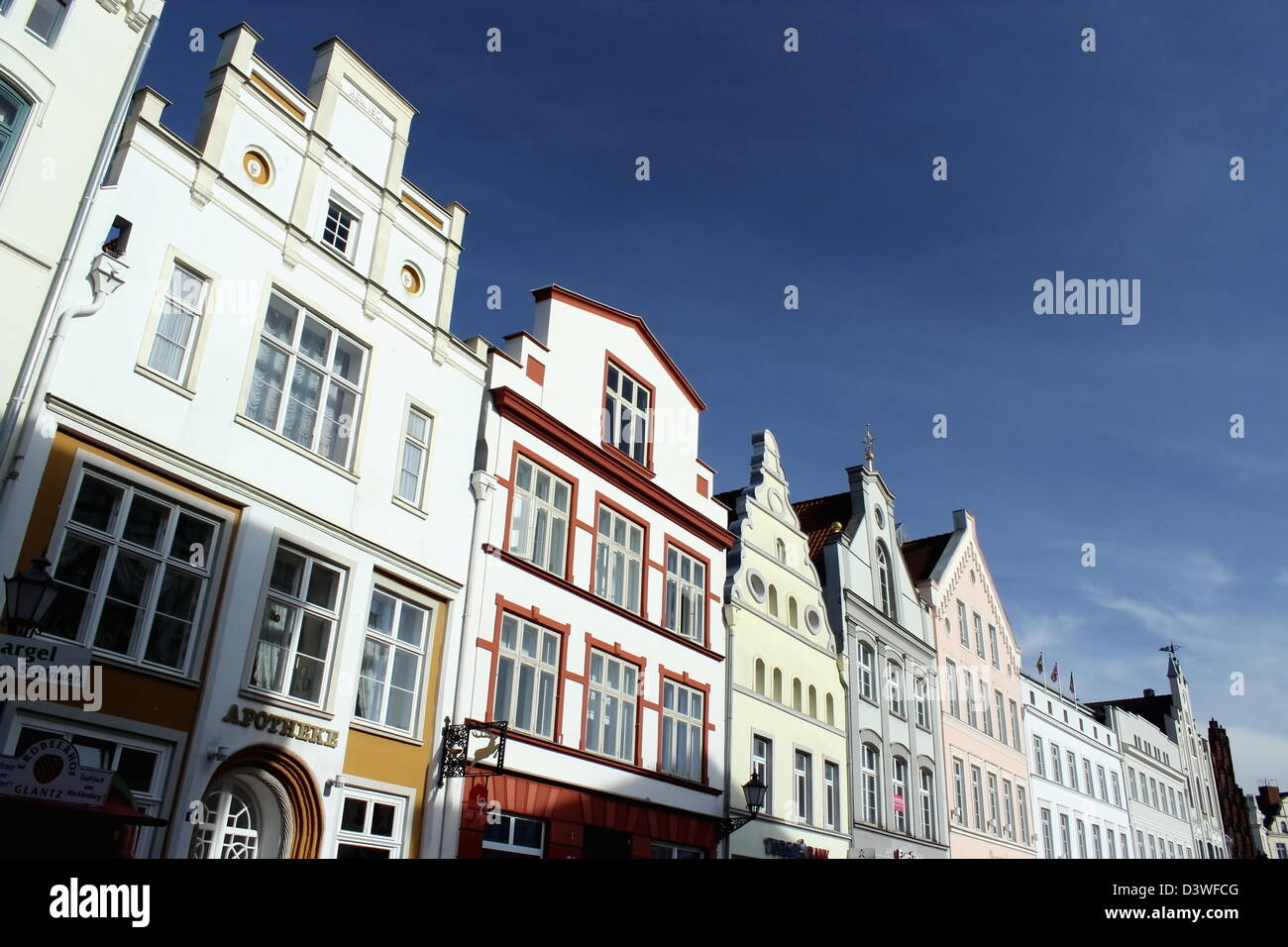Raw of beautiful old houses on a sunny day, Wismar, Germany - Stock Image