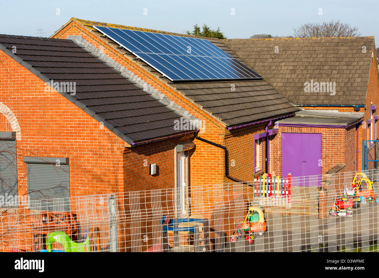 A nursery school in Seaton near Workington, Cumbria UK, with solar panels on the roof. - Stock Image