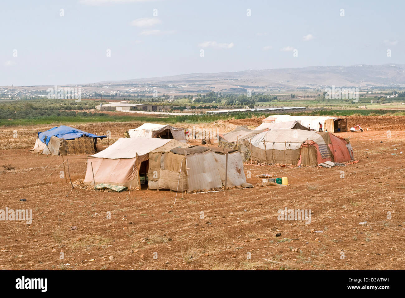 A tent refugee camp for Syrian migrants on a farm in the northern Lebanese region of Wadi Khaled, just south of Stock Photo