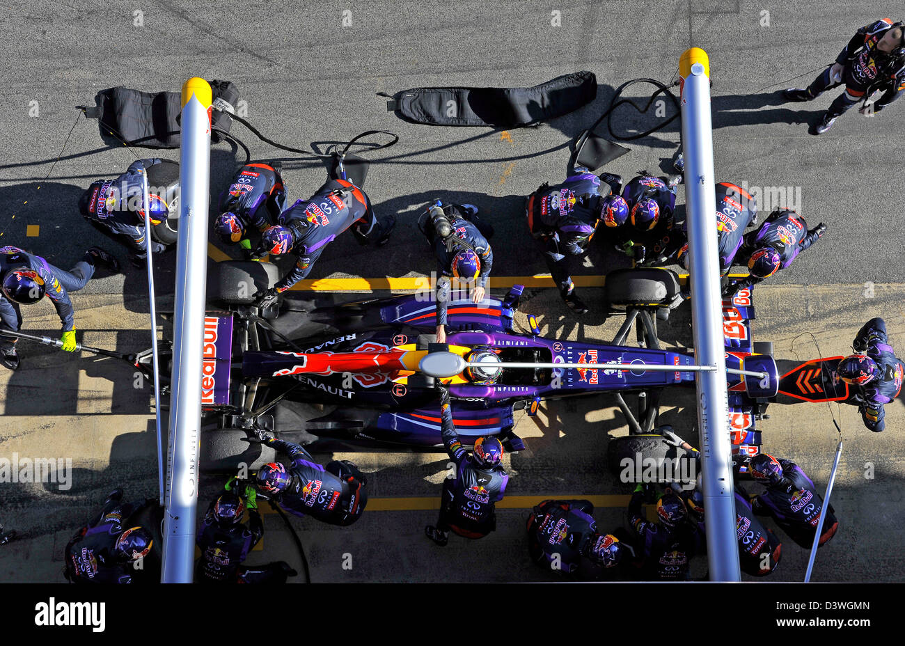 Sebastian Vettel (GER),Red Bull Racing RB9 and his mechanics practice pit stop during Formula One tests on Circuit - Stock Image