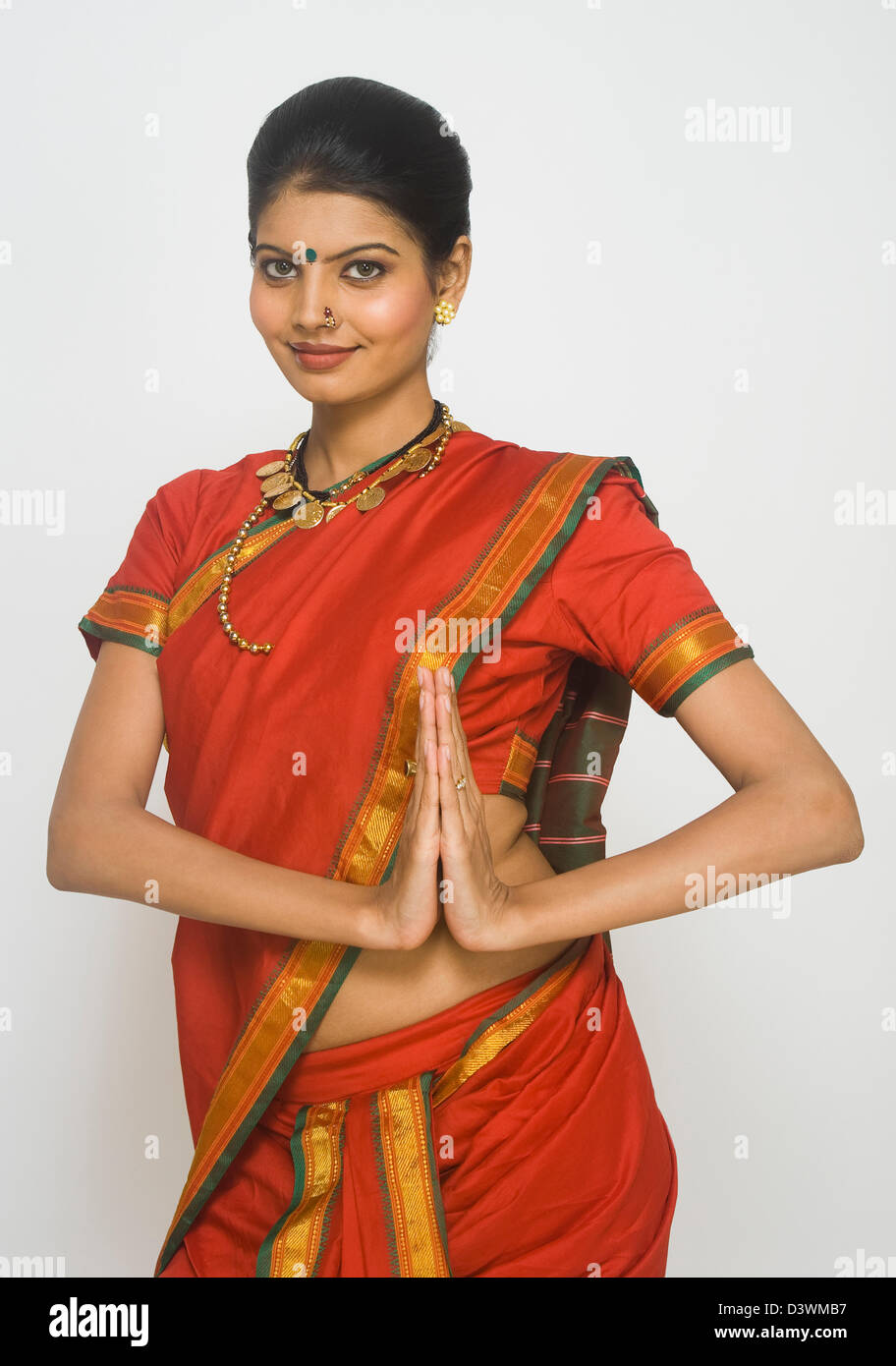 Portrait of a Maharashtrian woman greeting in prayer position - Stock Image