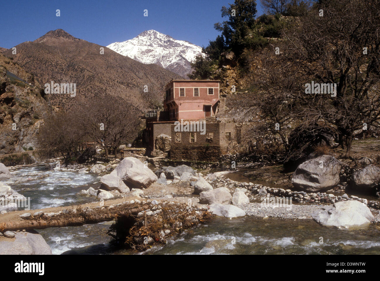 Stream in the Ourika valley Morocco, autumn with snow-capped Atlas - Stock Image