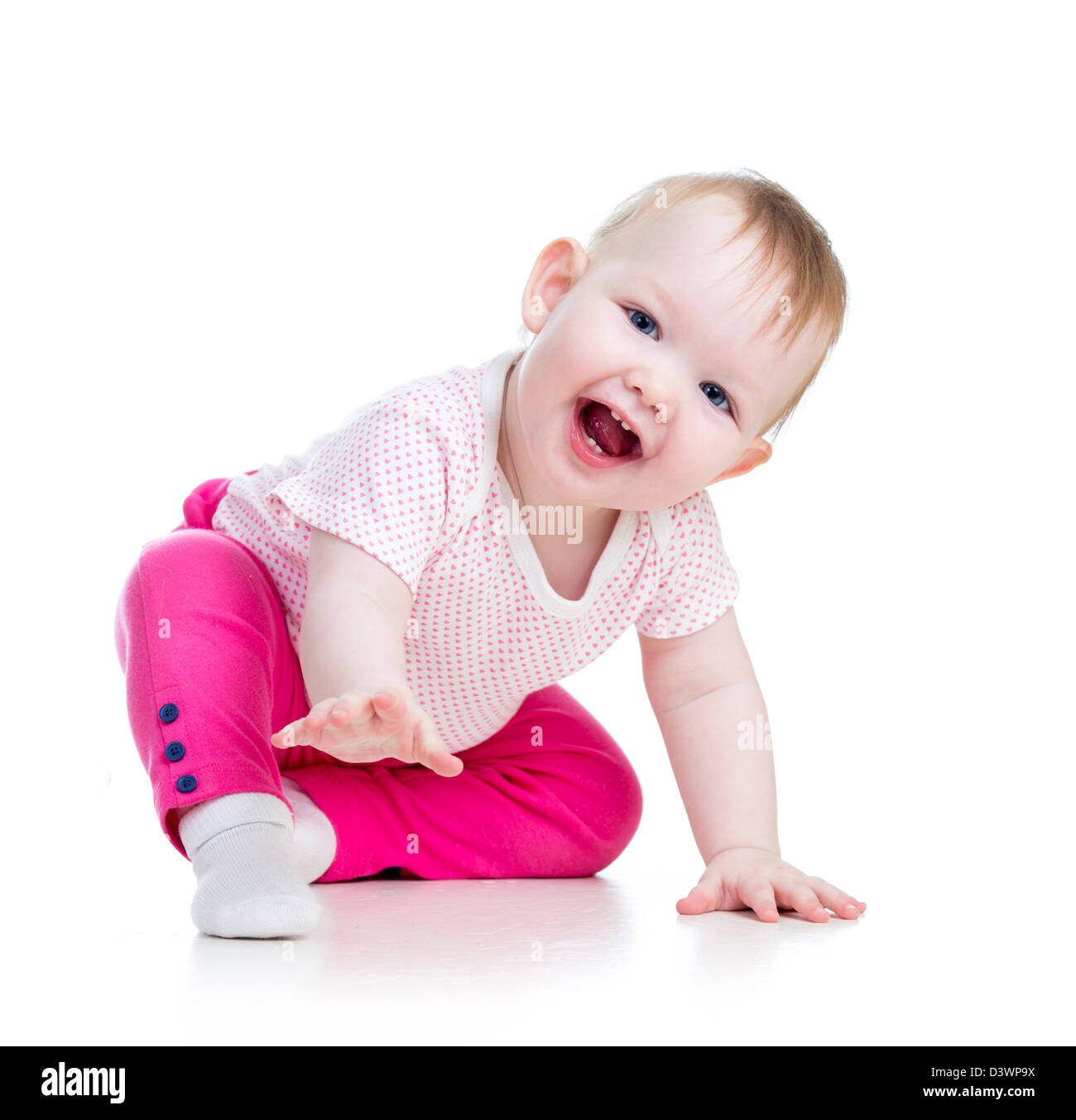 Funny baby sitting on the floor, isolated over white - Stock Image