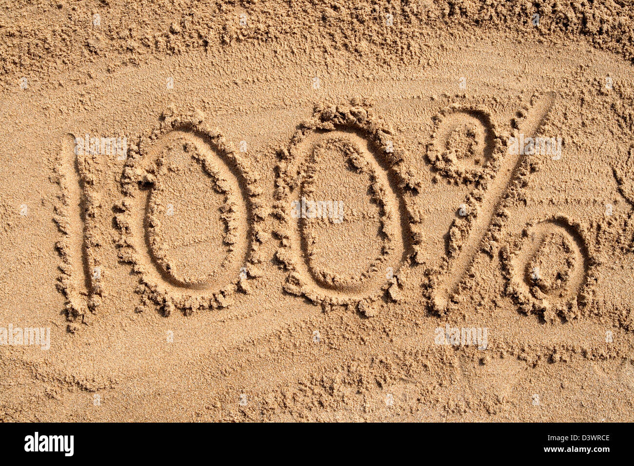 100% written on a sandy beach. - Stock Image