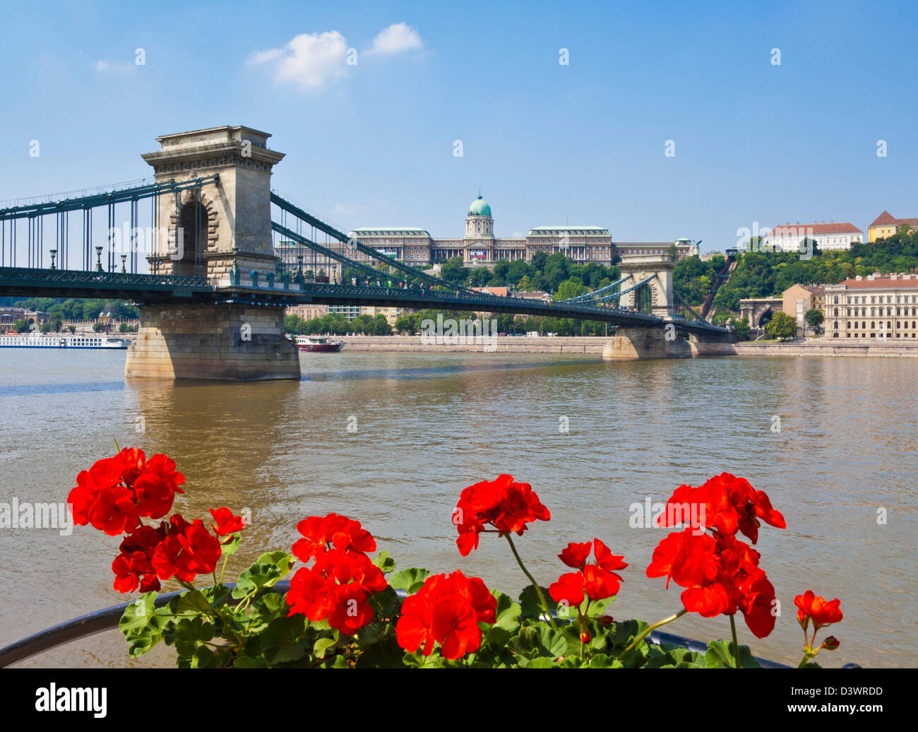 Chain Bridge Szechenyi Lanchid over the River Danube with the Hungarian National Gallery behind Budapest Hungary - Stock Image