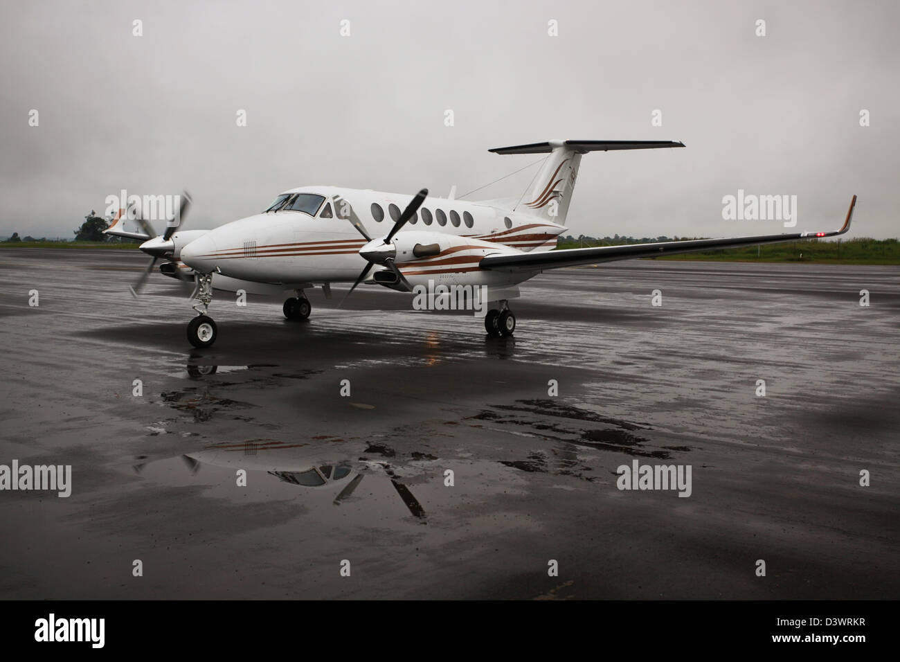 Beechcraft twin engine turboprop First Quantum plane at Solwezi airstrip in light rain - Stock Image