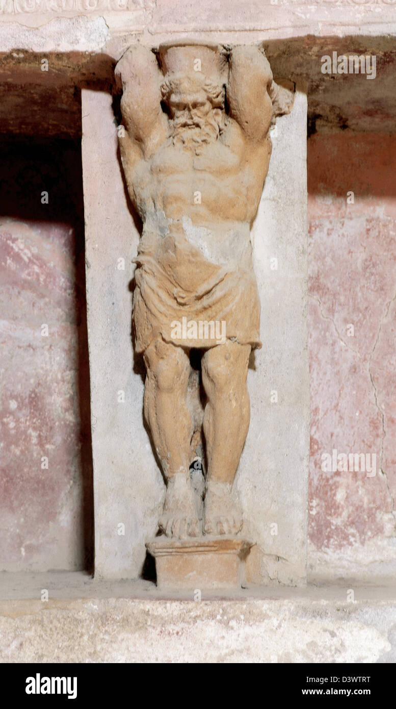Roman art. Italy. Pompeii. Forum baths. Built around 80BC. Tepidarium (warm room). Detail of the Titan Atlas. Inside. - Stock Image