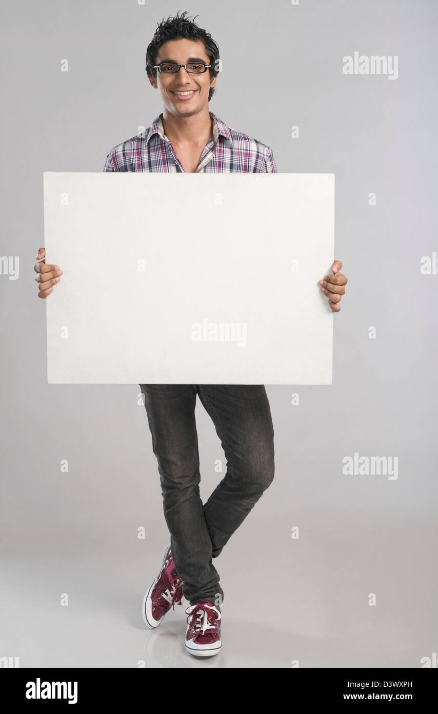 Man standing with a placard - Stock Image