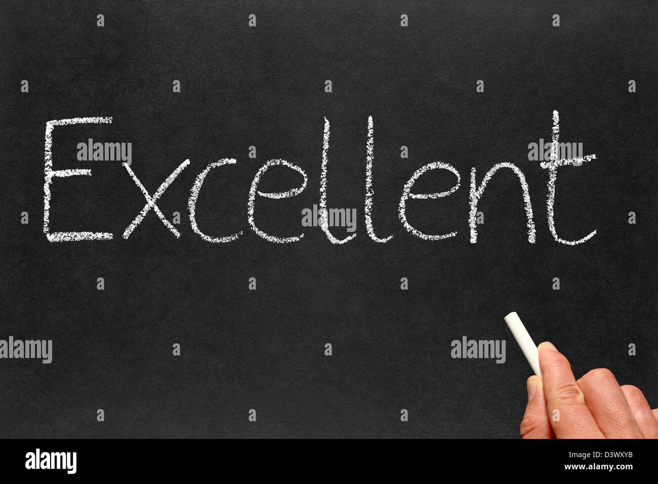 Writing excellent on a blackboard. - Stock Image