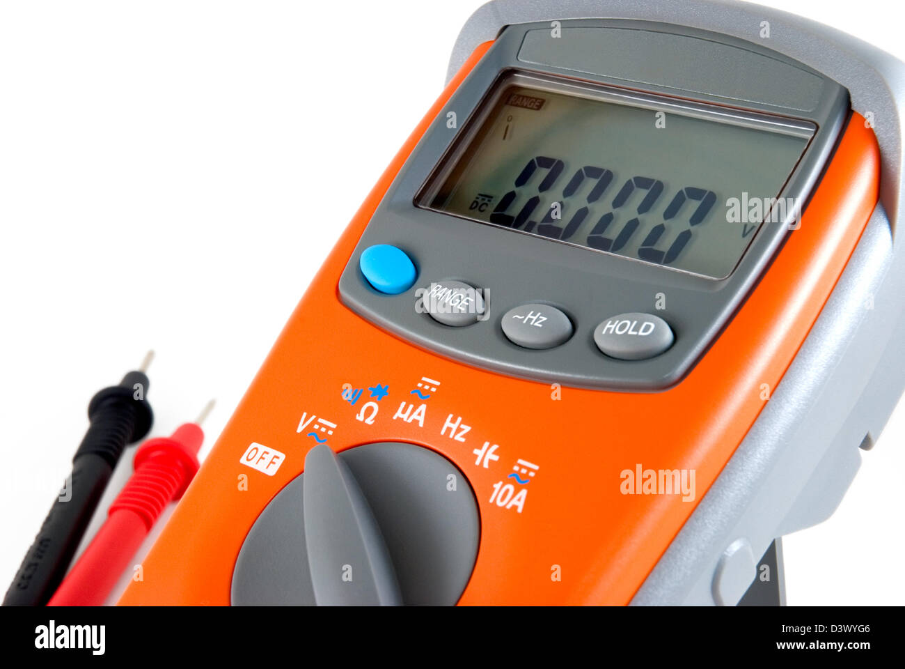 The orange multimeter is photographed on a white background - Stock Image