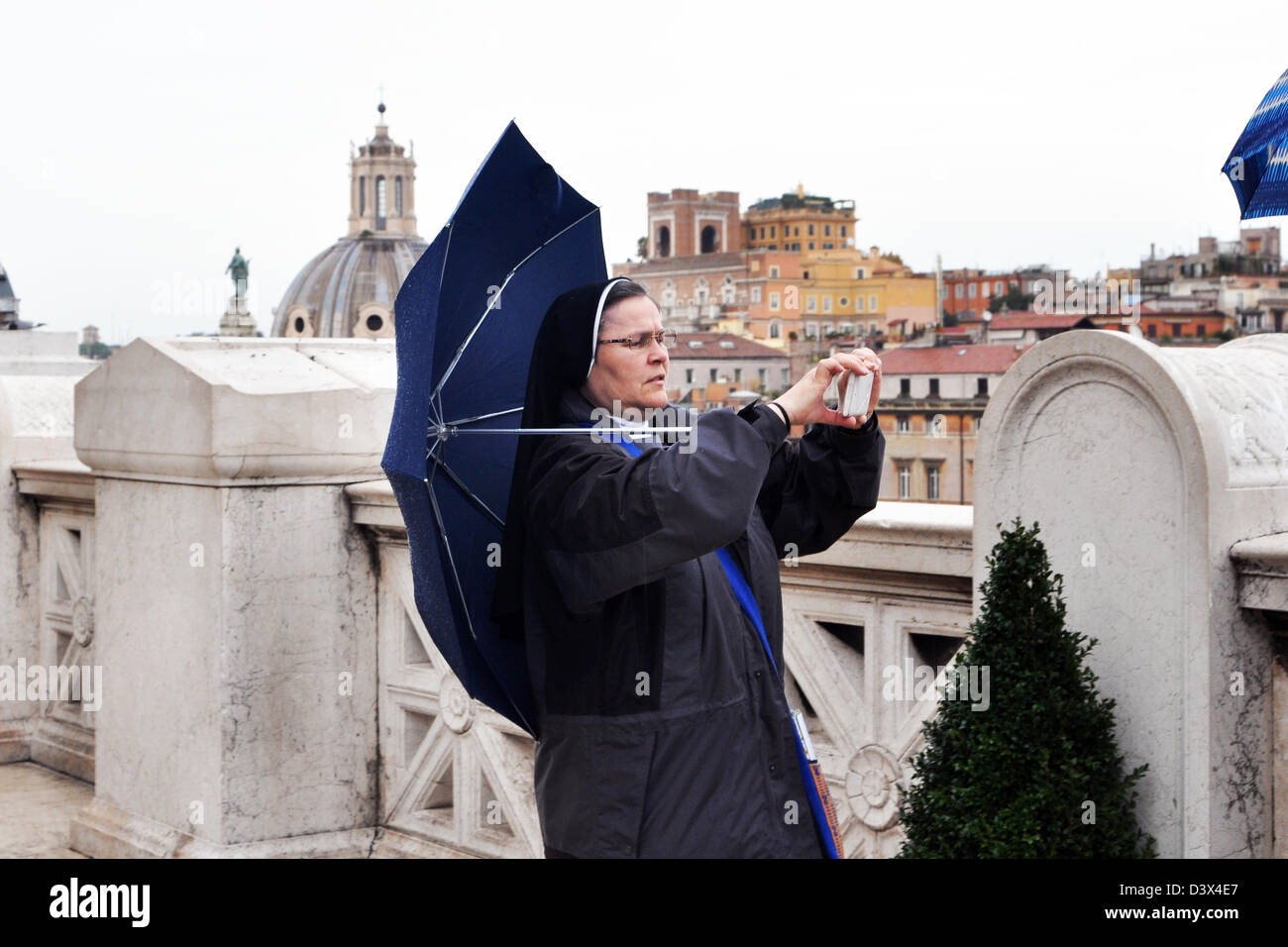 A nun takes a picture at the Capitoline Hill, Rome, Italy - Stock Image