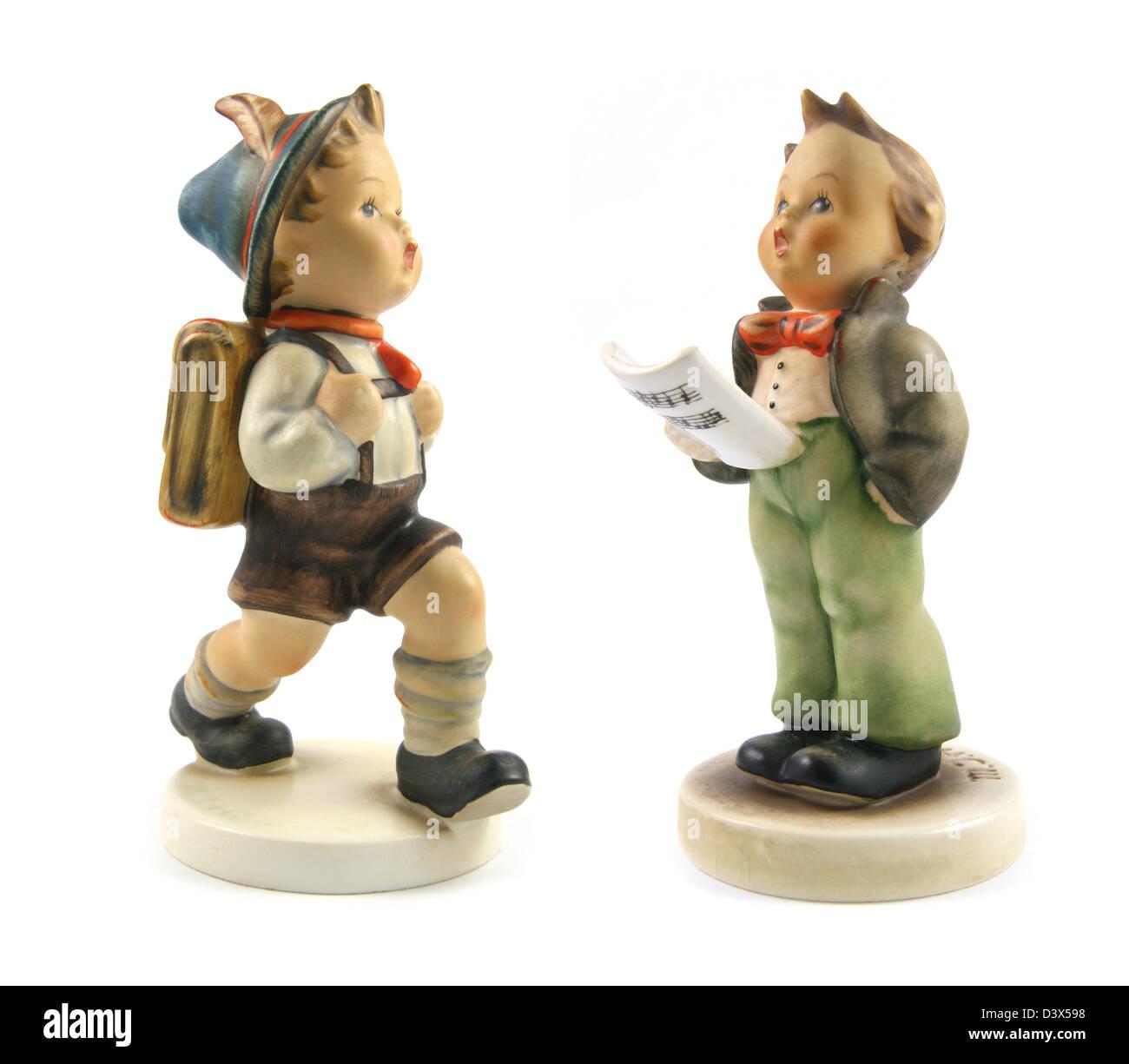 Goebel Hummel figurines: School Boy (left) and The Soloist. - Stock Image