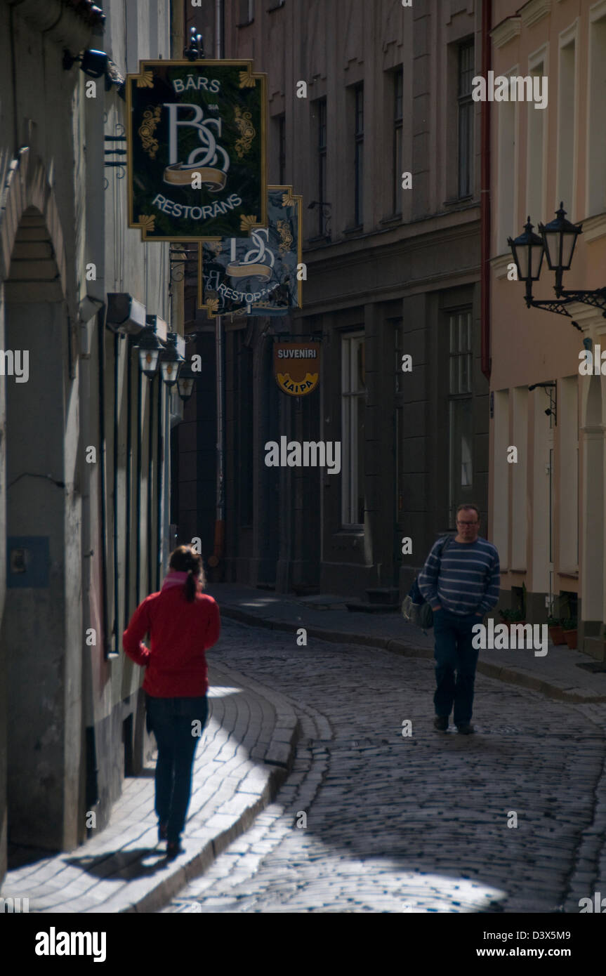 Two  shadowy figures on Laipu iela,Riga Old Town,Riga,Latvia,Baltic States - Stock Image