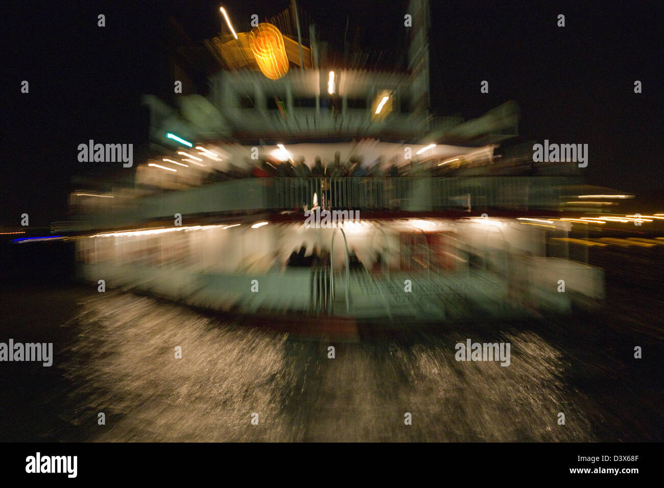 A Thames Charter cruise boat at night Stock Photo